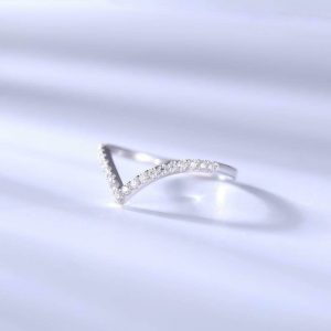curved moissanite wedding band