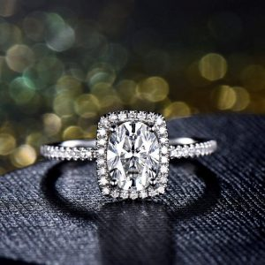 oval cut halo moissanite ring